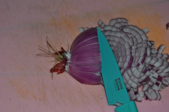 Now cut horizontally across your onion, stopping 1/2cm from the roots (which can now be discarded).